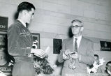 Richard Darrell presenting a gift to Harold Garver in 1954