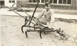 Eugene Needham with a cultivator he rebuilt circa 1935