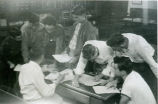 F.F.A. members compiling data for the chapter report in 1954