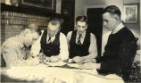 Four F.F.A. boys at a desk in a classroom at Shawnee Mission Rural High School circa 1938