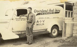 Robert Alcorn beside a milk truck circa 1938