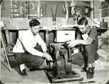 Jerry Goddard and Kenny Olson working on a motor in F.F.A. shop