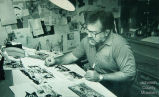 Cartoonist Bob Bliss in his studio