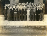 Group of F.F.A. boys and Harold Garver in front of Shawnee Mission Rural High School circa 1938