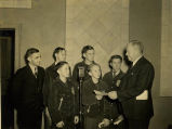 Harold Garver and F.F.A. boys presenting Phil Evans of KMBC a honorary degree circa 1939