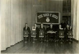 Harold Garver and F.F.A. chapter officers with F.F.A. symbols and banners