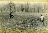 F.F.A. boys setting out an orchard for Mrs. Singleton circa 1940